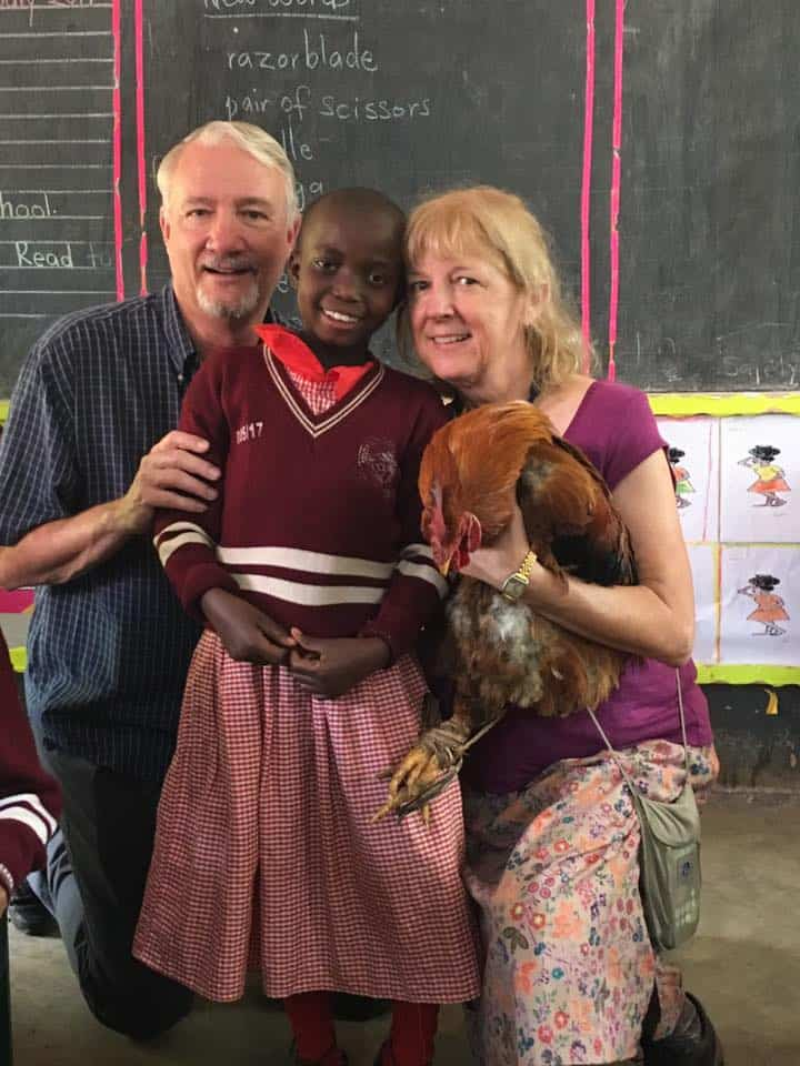 sponsors with student and chicken