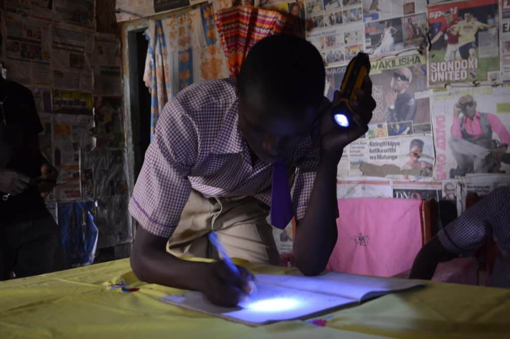 student studying with flashlight